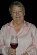 Sara Spayd holding red wine in glass